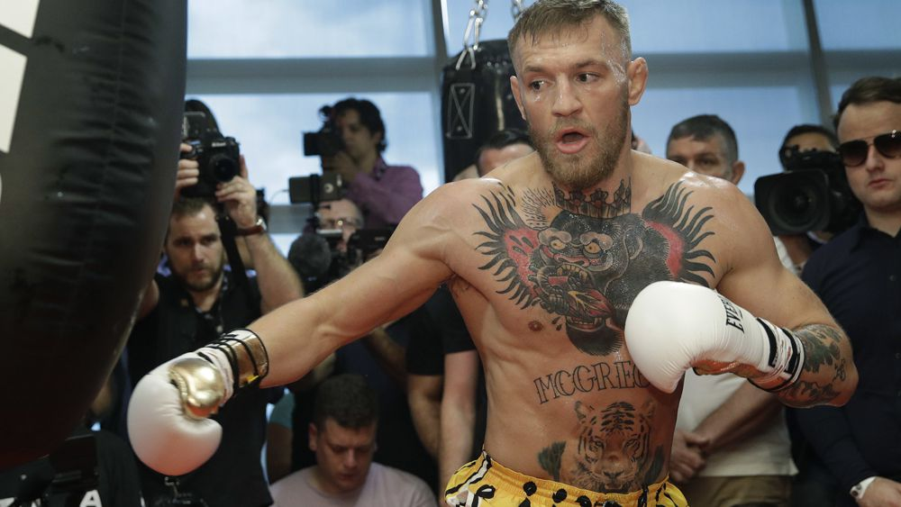 Conor McGregor v Floyd Mayweather bout gets approval for smaller 8-ounce gloves, referee and judges also confirmed