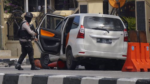 Prosecutors say the Islamic cleric directed his followers to conduct the attacks, including this incident where sword-wielding men drove into police headquarters in Sumatra this week. Picture: AAP.