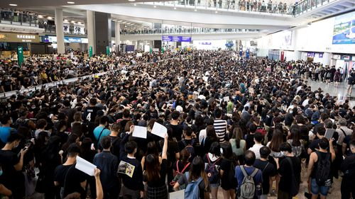 Hong Kong cancels 130 flights as protesters flood its airport