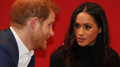 Britain's Prince Harry and his fiancee Meghan Markle look on as they tour the Terrence Higgins Trust World AIDS Day charity fair at Nottingham Contemporary in Nottingham, England, Friday, Dec. 1, 2017. It was announced on Monday that Prince Harry and American actress Meghan Markle are engaged and will marry in the spring of 2018. (Adrian Dennis/Pool Photo via AP)