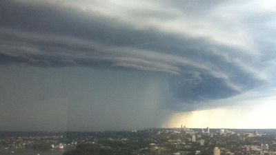The storm front moves across the city, bringing rain. (Hamish Forbes)