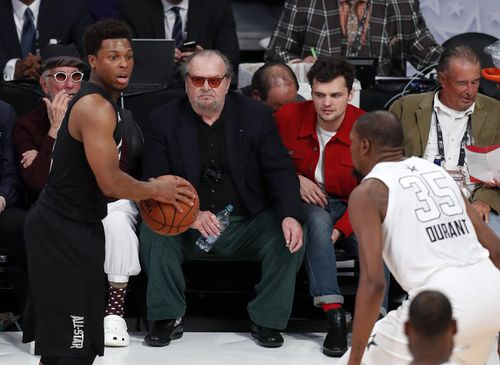 Jack Nicholson watches the action from the sidelines. (AAP)