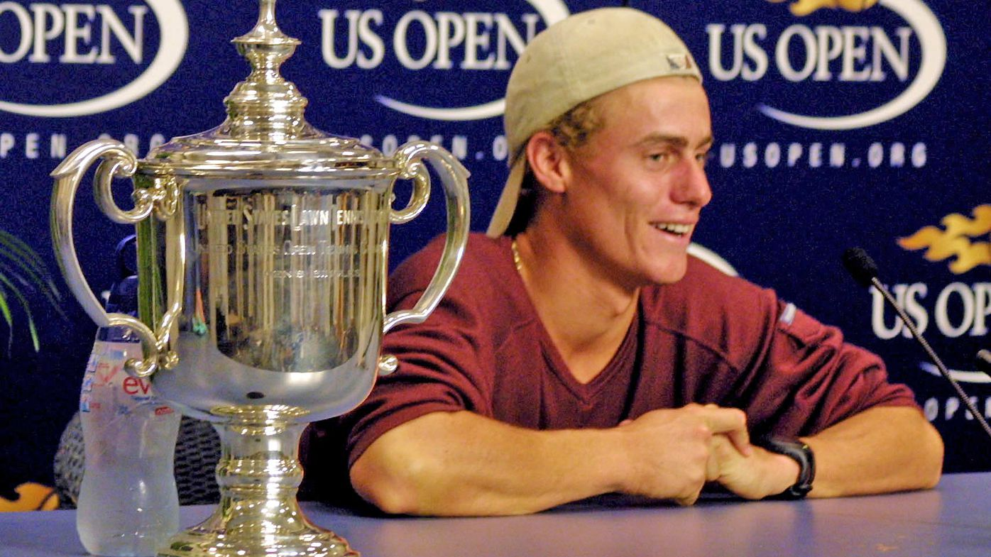 Lleyton Hewitt shares a laugh with the press, with the US Open Trophy
