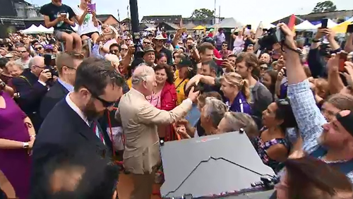 A large crowd turned out to greet the heir to the throne before he touched down at 11.30am.