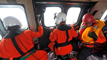 Crew members of Indonesian Air Force in search operation for victims of AirAsia Flight 8501. (AAP)