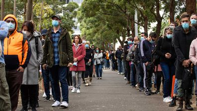 Hundreds line up to recieve a COVID-19 vaccination at the NSW Health Vaccinination Centre in Homebush.