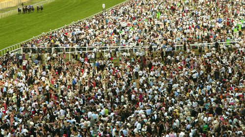 A huge crowd gathers for the races, drawn from the UK's middle and upper classes. (Getty)