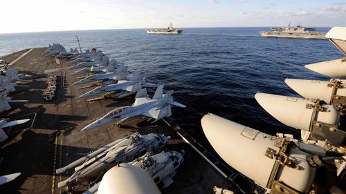 Eight rescued, three missing after US Navy aircraft crash
