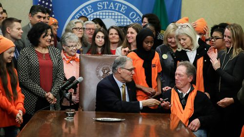 Washington Governor Jay Inslee recently signed a measure into law that bans the sale and possession of bump stocks. (AAP)