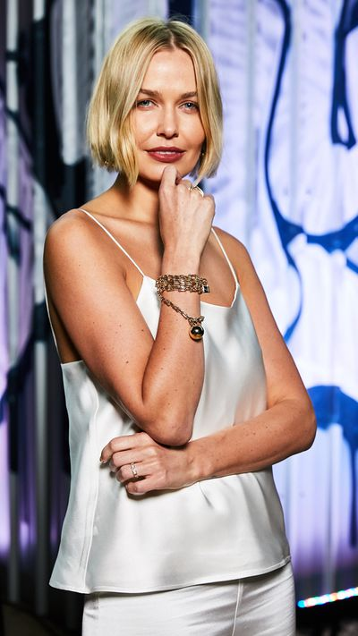 """<p><a href=""""http://style.nine.com.au/2017/04/07/10/47/style_lara-worthington"""" target=""""_blank"""">Lara Worthington</a> officially became Australia's answer to <a href=""""https://style.nine.com.au/2017/04/04/17/50/lady-gaga-tiffany"""" target=""""_blank"""">Lady Gaga</a> by hosting last night's lavish <a href=""""http://www.tiffany.com.au/?gclid=Cj0KEQjw9r7JBRCj37PlltTskaMBEiQAKTzTfMlb8F-FDdRPNBG-BS1Ztue4Y_T2lTEB-_6nqFJTWsYaAvAU8P8HAQ"""" target=""""_blank"""">Tiffany & Co.</a> celebration at Sydney's Carriageworks for the launch of the jewellery giant's HardWear collection. </p> <p> While Lady Gaga is the face of the brand internationally, Lara, 29, was called on to represent Tiffany & Co for the Australian celebration. </p> <p> Having returned to Sydney without 7-month old Racer, 2-year-old Rocket Zot and husband Sam Worthington, beauty entrepreneur and former swimsuit model, attended the event wearing a white ensemble from Australian designer Michael Lo Sordo.</p> <p> In a stylish nod to her hosts, Lara wore the $22,300 <a href="""" http://www.tiffany.com.au/jewelry/necklaces-pendants/tiffany-hardwear-wrap-necklace-60700923?fromGrid=1&search_params=p+1-n+10000-c+3691980-s+5-r+-t+-ni+1-x+-lr+-hr+-ri+-mi+-pp+0+&search=0&origin=browse&searchkeyword=&trackpdp=bg&fromcid=3691980 """" target=""""_blank"""" draggable=""""false"""">Tiffany & Co HardWear Wrap Necklace</a> as a bracelet at the party.</p> <p> The appearance will be a welcome boost for Lo Sordo who has faced business difficulties that took him to court last year. </p> <p> Also attending the event to promote Tiffany's & Co.s new collection, an attempt to capture a more youthful, edgy audience were bloggers Nadia Bartel and Kate Waterhouse and Australian sister act Say Lou Lou, who performed. <br> <br> </p>"""