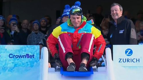 Simon Goodwin wore a winter-ready ski suit for the occasion. (9NEWS)