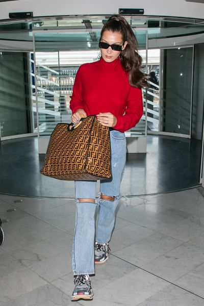 "<p>Bella Hadid at JFK Airport, June 2018</p> <p><strong><em>Slicked Back</em></strong></p> <p>""If you&rsquo;re wearing this look straight, straighten the hair before you secure the ponytail. Schwarzkopf Professional OSiS+ Flatliner heat protection spray is ideal for achieving a slick straight ponytail,"" Crawford added.</p>"