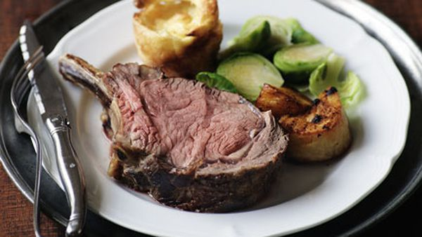 Prime rib of beef with Yorkshire puddings, roast potatoes and Brussels sprouts