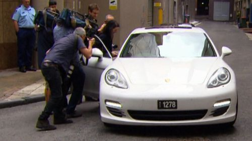 TV crews descend on Mehajer's friend's Porsche as he arrives to give him a ride home.