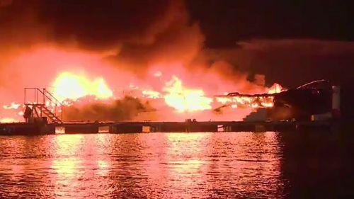 Fire burns through Abu Dhabi yacht club and destroys eight boats