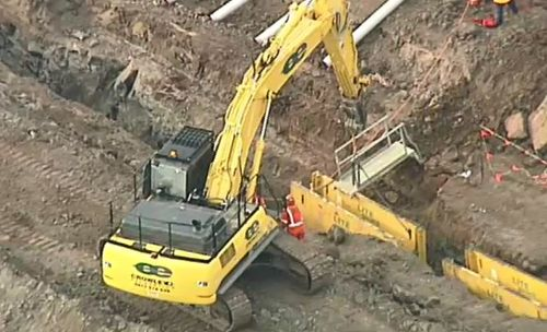 A worker has died after falling into a trench at a construction site north of Melbourne.