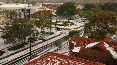 Anzac Parade in Maroubra has been transformed under a blanket of hail. Photo: Alex Szitniak