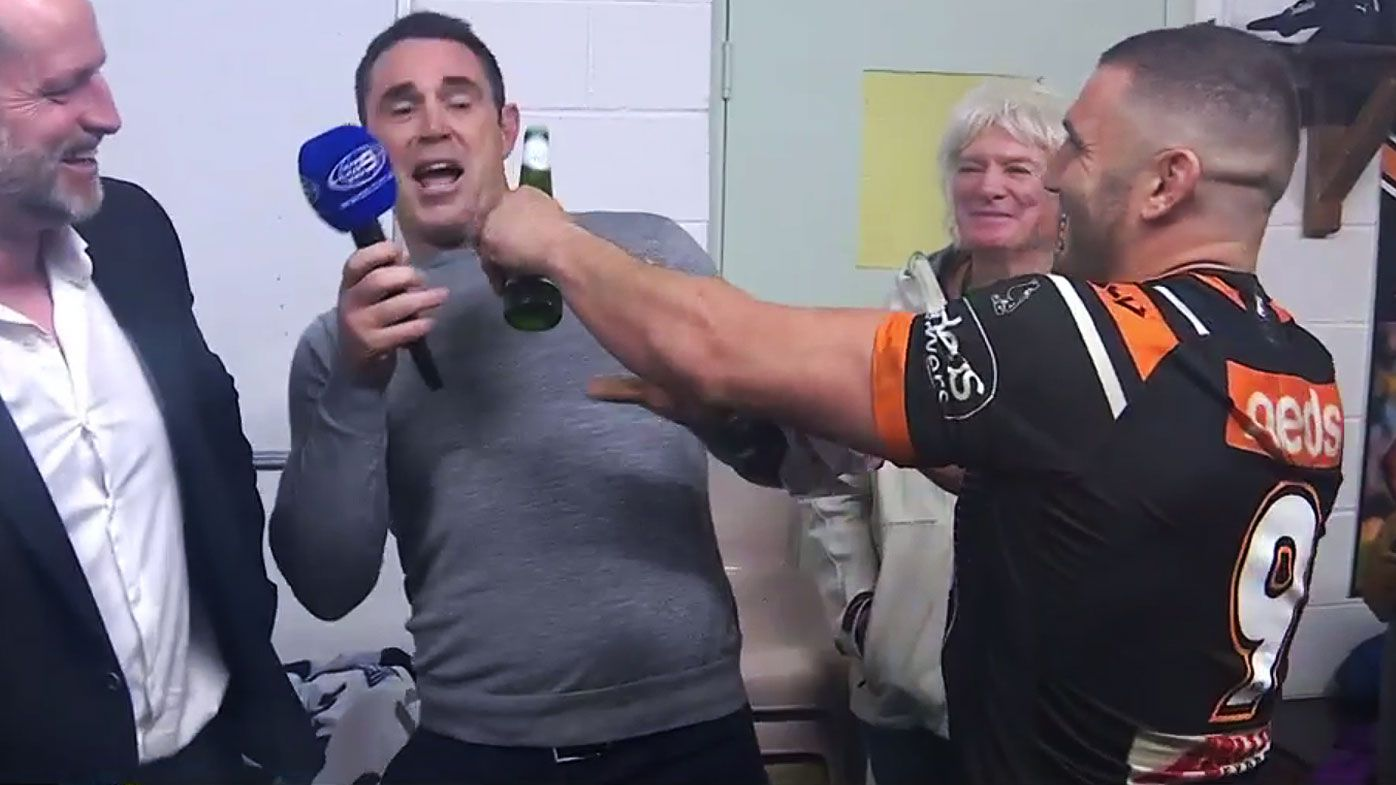 'I can't mate!': Rowdy Robbie Farah springs beer on Brad Fittler after Tigers win