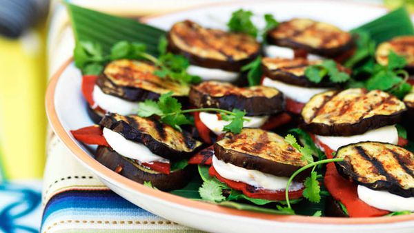 Eggplant 'quesadillas' with spinach, mozzarella and roasted red capsicum