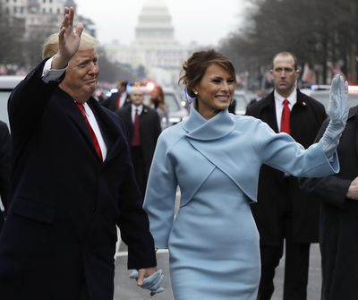 The First Lady shocked many when she attended the official Inauguration Day festivities in a powder blue double-face cashmere dress and coat by US designer Ralph Lauren. The choice was distinctly different from anything we have seen her wear before plus, it was reminiscent of styles worn by the former First Lady the late Jackie Kennedy Onassis.