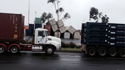 Toppled-over shipping containers. (Jatinder Aashat)