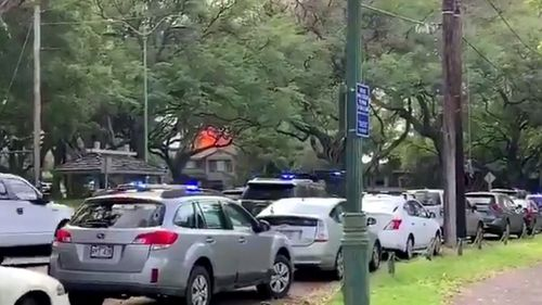 Homes Burn After Shooter Kills 2 Honolulu Officers