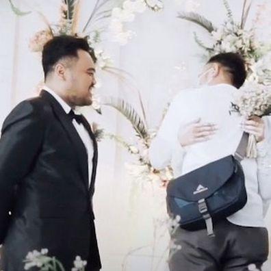Groom winces as wife-to-be hugs ex-boyfriend 'one last time'