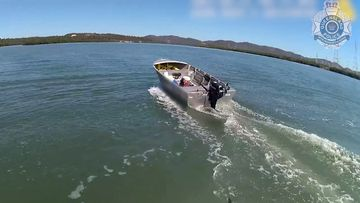The unmanned tinny runs loose after the fisherman was knocked out of the vessel from another boat's wake.