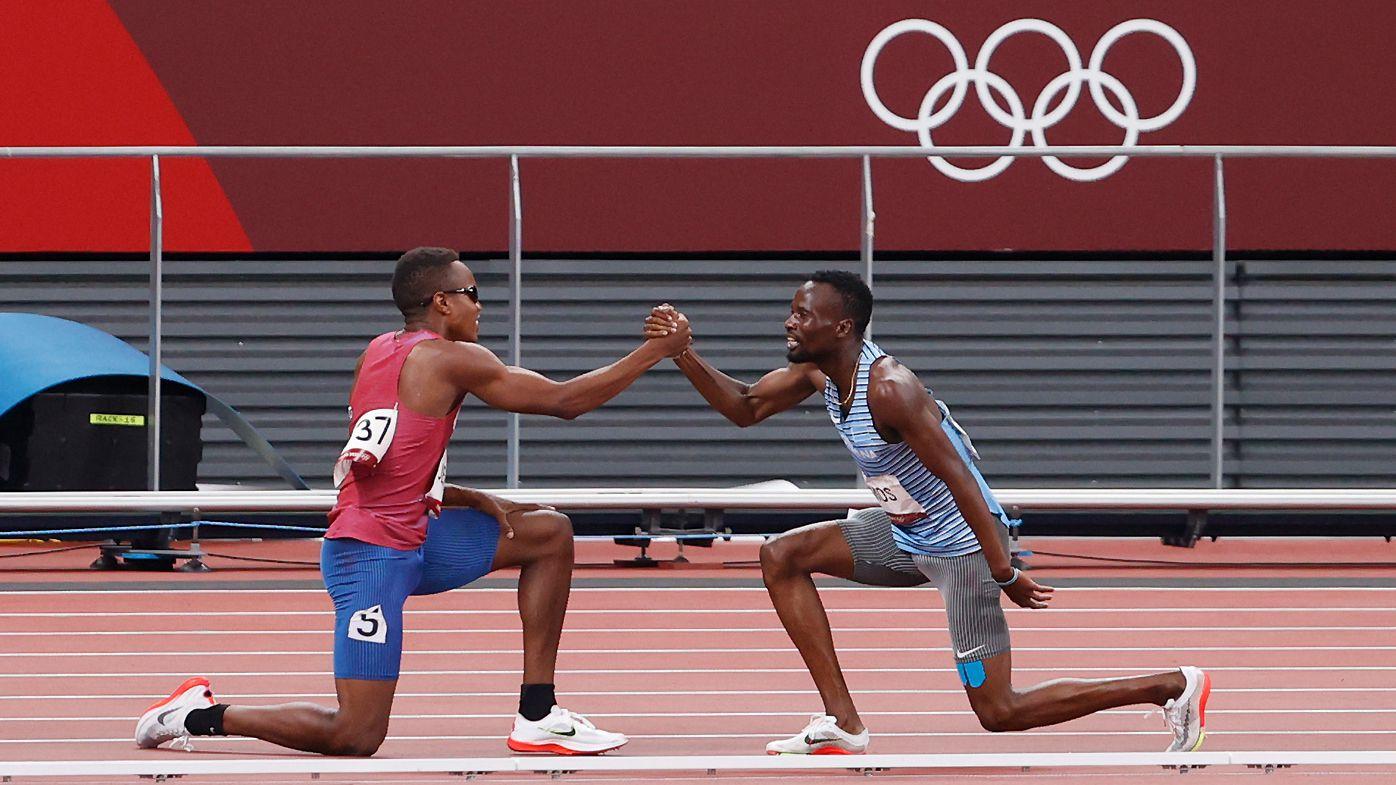 Isaiah Jewett of the USA and AMOS Nijel of Botswana shake after the fall