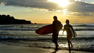 People enjoy the water at sunrise at Bondi Beach in Sydney on January 18, 2017. (AAP)