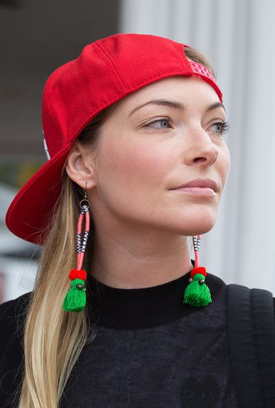 Fashion is all about the unexpected. Try a laidback cap with tribal-inspired earrings.