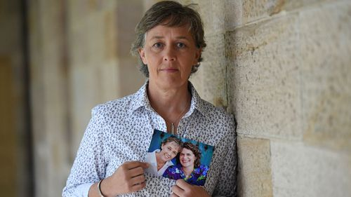 Jill Kindt holds a photo of her with her late wife Jo Grant. (Image: AAP)