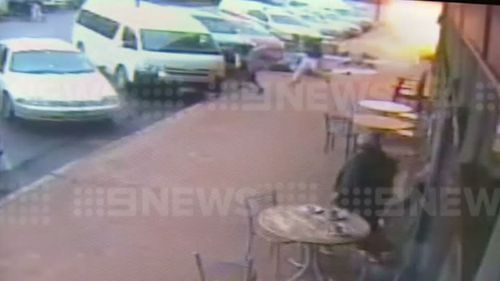 Patrons stand up, dazed by the blast. (9NEWS)
