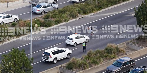 Police arrested a man after  an allegedly stolen vehicle crashed into other cars near the entrance to the Burnley Tunnel.