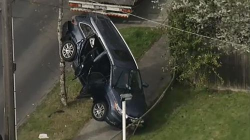 Elderly Melbourne driver causes crash that lands another car against a tree