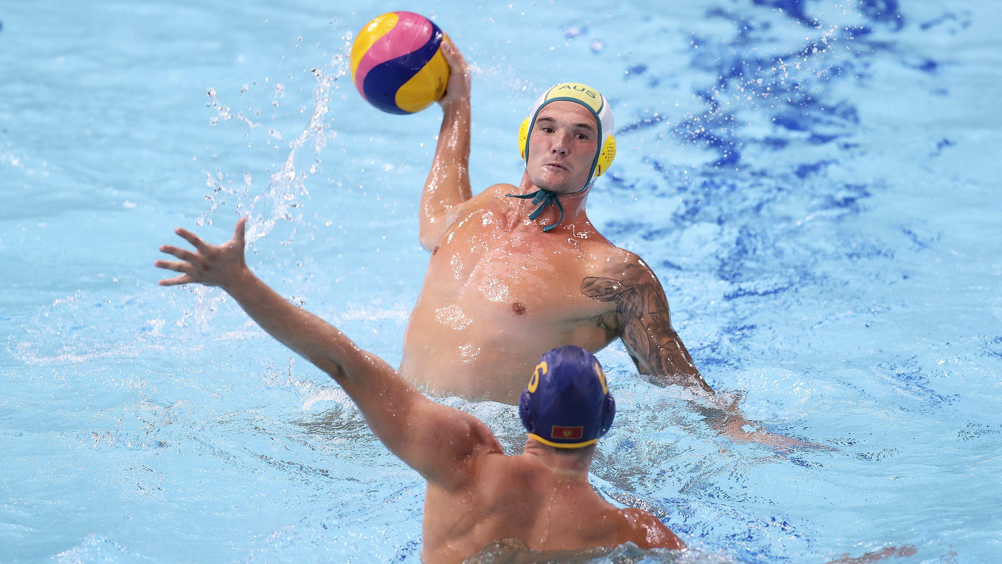 Australia's Aaron Younger prepares to shoot against Montenegro.