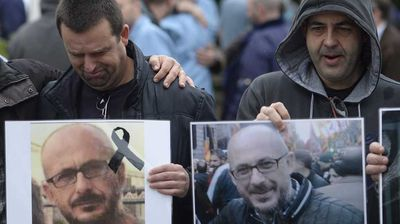 <p>Spanish workers from the Delphi factory hold a picture of their colleague Manuel Rives, who died in the Germanwings flight crash, as they grieve after a minute of silence in Sant Cugat del Valles, near Barcelona, Spain.</p><p> Other victims included a young married couple as well as numerous Catalan business figures, including four members of the same family. (AAP)</p>
