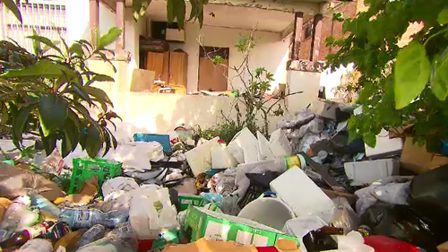 The Bondi house has knee-high rubbish in every square inch of the property.