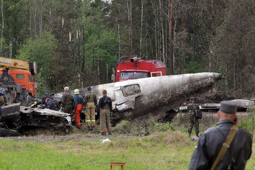 Russian emergency services and rescuers stand near debris of a Russian Tupolev-134 plane after it crashed near the airport of Petrozavodsk, Karelia province, Russia, 21 June 2011. Forty-four people died and eight survived when an airliner crashed overnight in north-western Russia, the Civil Defence Ministry said 21 June. The Russair charter flight from Moscow crashed about midnight (2000 GMT 20 June 2011) as it approached its destination of Petrozavodsk, 400km north-east of St Petersburg in Russia's Republic of Karelia, which borders Finland. The Tupolev Tu-134 with 43 passengers and a crew of nine on board made a hard landing on a highway about a kilometre from the airport at Petrozavodsk, the capital of Karelia, news reports said. EPA/ANATOLY MALTSEV
