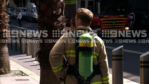 Specialist HAZMAT crews outside the building in Sydney's CBD.