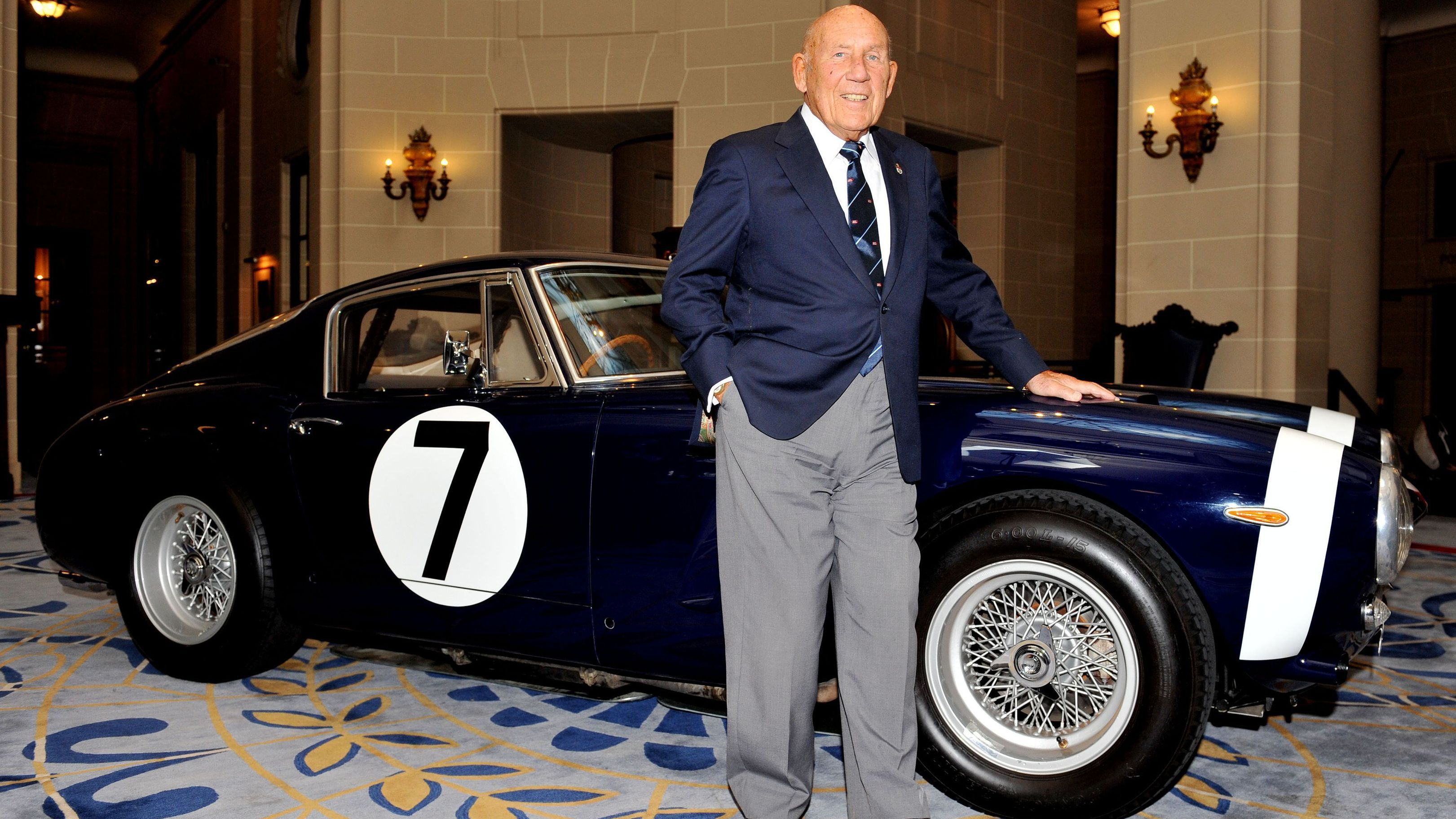 Sir Stirling Moss stands in front of the Ferrari 250 GT SWB back in 2015, which he raced to victory in the Goodwood Tourist Trophy in 1961.