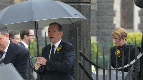 Prime Minister Tony Abbott arrives at the memorial service for MH17 victims at St Patrick's in Melbourne. (AAP)