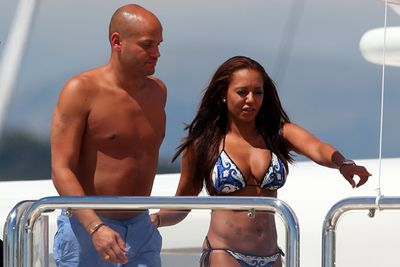 Another bikini-clad babe toting around her man was Spice Girl Mel B, on a yacht in Cannes with husband Stephen Belafonte.
