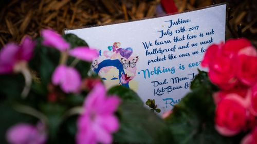 A memorial for Justine Ruszczyk Damond is seen near the alley where she was killed.