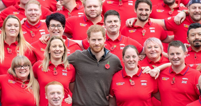 Prince Harry poses with Invictus volunteers during an event in June.