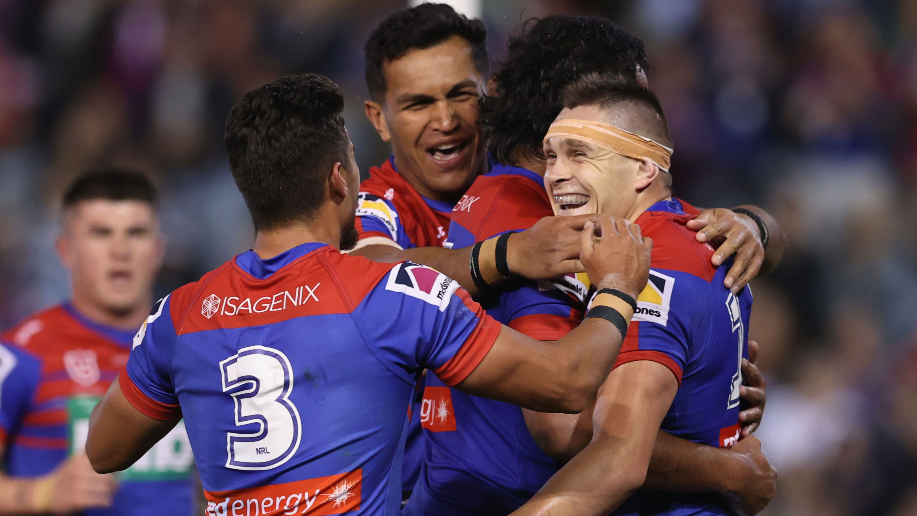 Brodie Jones celebrates a try with Knights teammates.