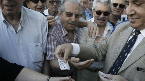 Greece begins debt payback, opens up banks