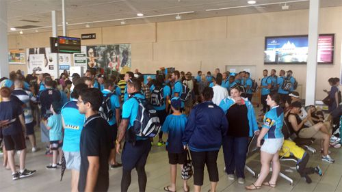 The Gold Coast Titan arrive at the Gold Coast airport following an NRL trial in Cairns. (AAP)