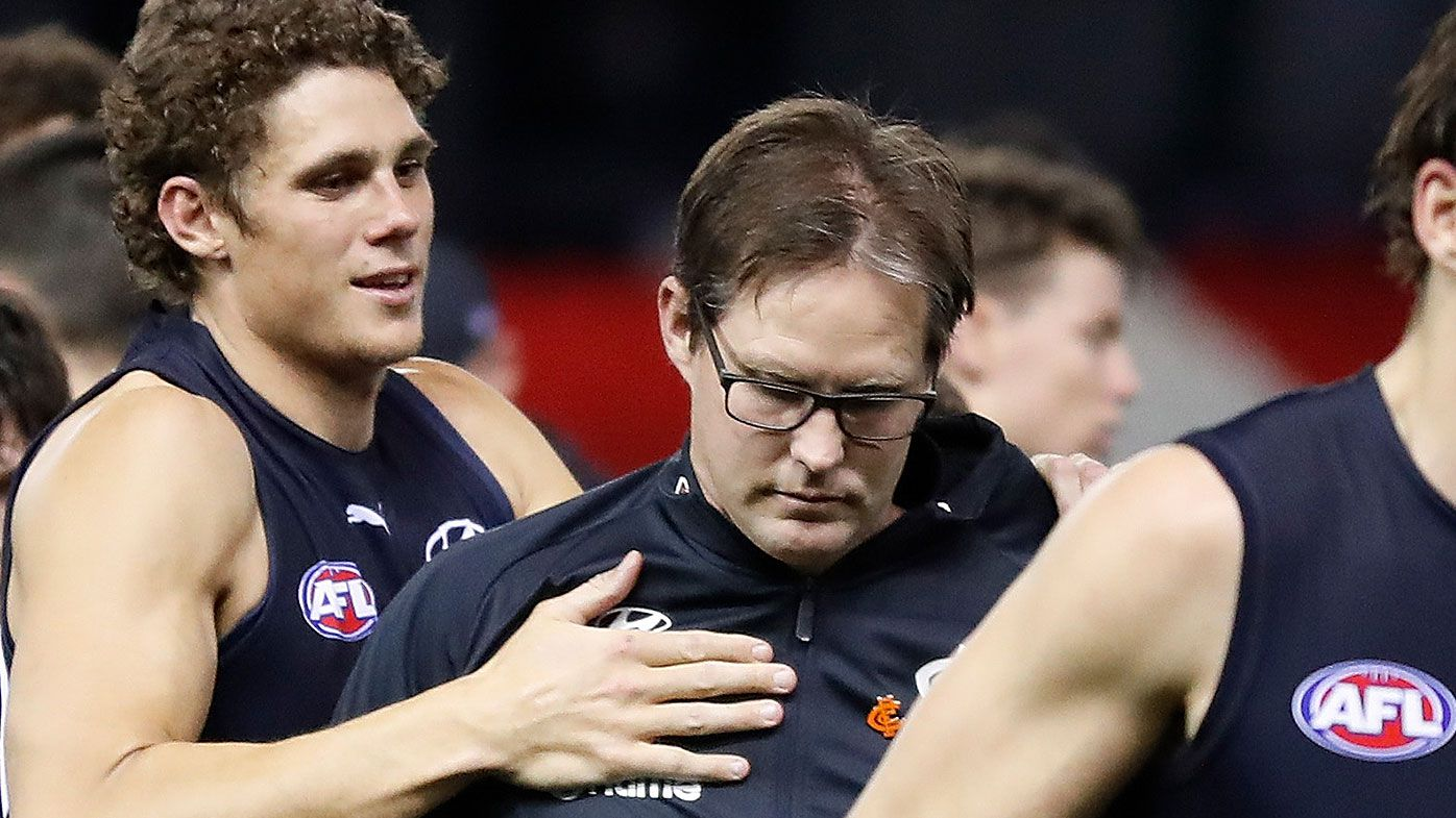 David Teague, Senior Coach of the Blues is consoled by Charlie Curnow of the Blues at three quarter time during the 2021 AFL Round 23 match between the Carlton Blues and the GWS Giants at Marvel Stadium on August 21, 2021 in Melbourn