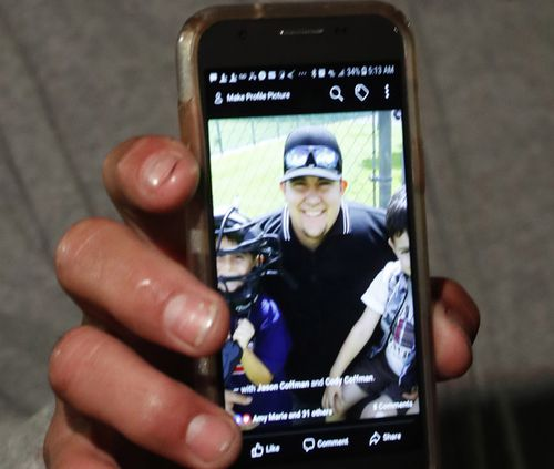 Jason Coffman showed pictures of his son, who he said was at the Borderline Bar for a college night event at the time of the shooting.